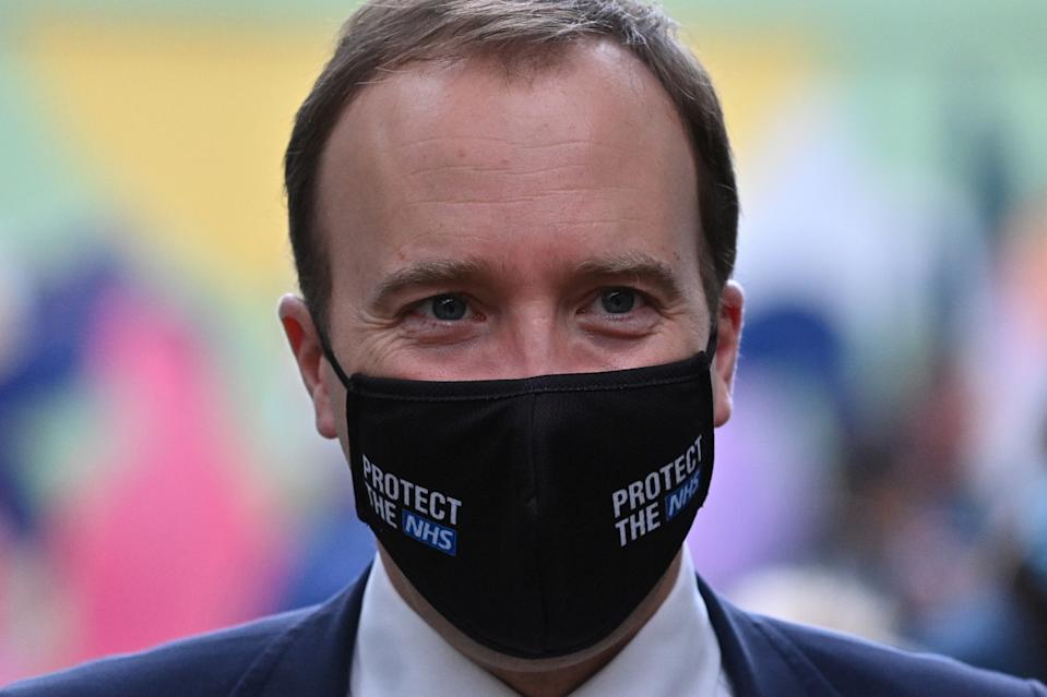 LONDON, ENGLAND - OCTOBER 27: Britain's Health Secretary Matt Hancock wearing a face mask during a visit with Britain's Camilla, Duchess of Cornwall (unseen) to watch a demonstration by the charity Medical Detection Dogs, which trains dogs to detect the odour of human disease at Paddington Station on October 27, 2020 in London, England. (Photo by Justin Tallis - WPA Pool/Getty Images)