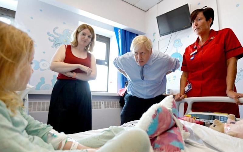 Bedside mannerisms | Boris Johnson meets Scarlett Gibbons, five, during a visit to the paediatric unit of the Royal Cornwall Hospital in Truro yesterday - 2019 Getty Images