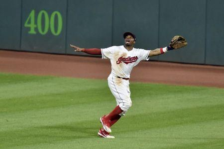 Jun 18, 2018; Cleveland, OH, USA; Cleveland Indians center fielder Rajai Davis (26) calls for a fly ball in the seventh inning against the Chicago White Sox at Progressive Field. Mandatory Credit: David Richard-USA TODAY Sports