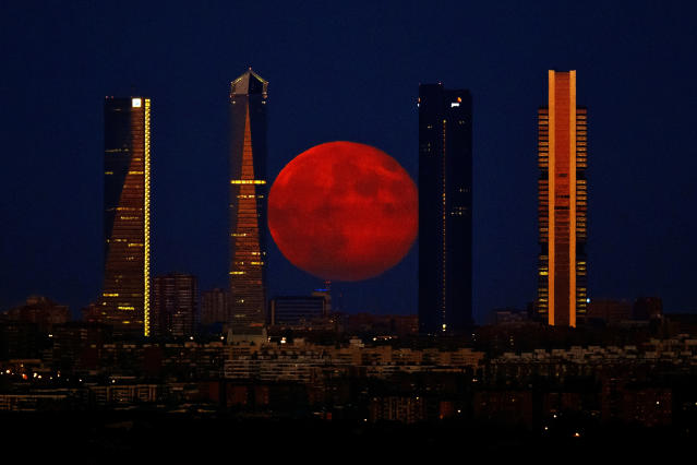 <p>The moon rises in the sky as seen through the Four Towers, or C.T.B.A. (Cuatro Torres Business Area), one of the most recognizable aspectx of Madrid, Aug. 11, 2014. (Photo: Daniel Ochoa de Olza/AP) </p>