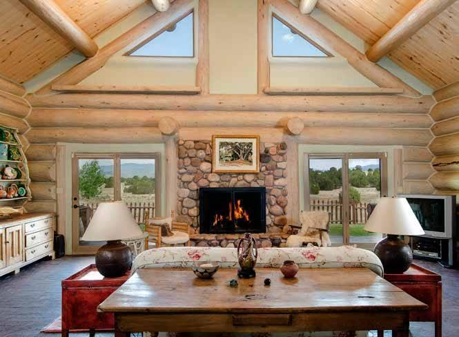 """<p>Fonda stayed in the Log House for a couple of years after she bought Forked Lightning Ranch, refurbishing it and the Hacienda while building the River House.<i> <i>(Photo: <a href=""""http://bit.ly/1oZ16Zz"""" rel=""""nofollow noopener"""" target=""""_blank"""" data-ylk=""""slk:Swan Land Company"""" class=""""link rapid-noclick-resp"""">Swan Land Company</a>)</i><br></i></p>"""