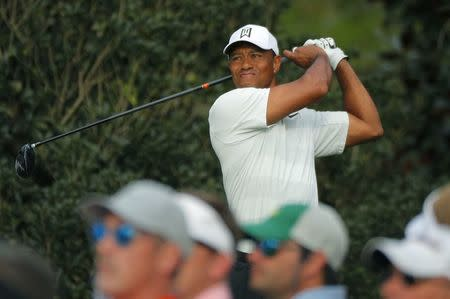 Patrick Reed storms into Masters lead, Tiger Woods just makes cut
