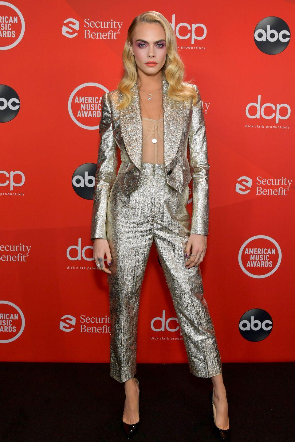 <p><strong>22 November </strong>Cara Delevingne styled her metallic Dolce & Gabbana suit with a nude Christian Dior corset. </p>