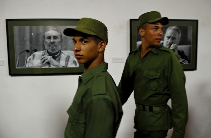 "Cuban soldiers visit the ""Fidel"" audiovisual exhibition in Havana, that is dedicated to ex-president Fidel Castro (AFP Photo/Yamil Lage)"