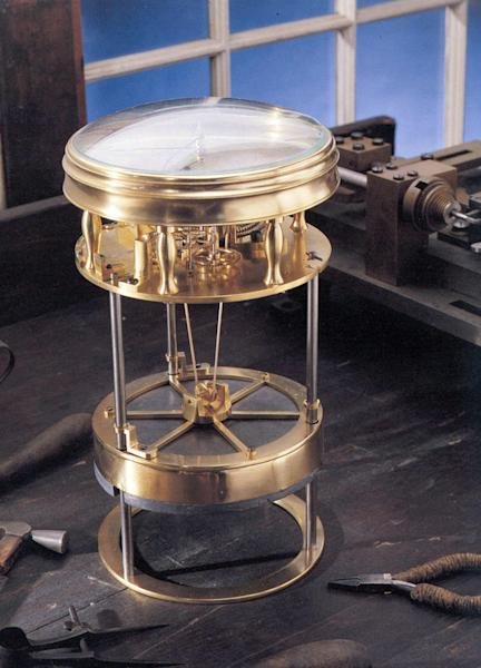 """This undated handout provided by the Smithsonian shows a timekeeper that was the first American-made marine timekeeper taken to sea. William Cranch Bond, a 23-year-old Boston clockmaker, crafted it during the War of 1812. In the age of hand-held GPS devices, navigating by the stars may seem quaint and irrelevant. So it may come as a surprise that it took hundreds of years to develop the tools needed to find our way across oceans, through the air and into deep space. On Friday, the Smithsonian's National Air and Space Museum is opening its first major exhibition: """"Time and Navigation: The Untold Story of Getting from Here to There."""" It shows the evolution of marine, air and space navigation, as well as a glimpse of the future with one of the first robotic-driven cars. (AP Photo/Smithsonian)"""