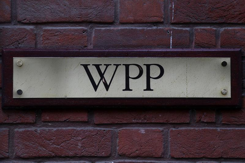 FILE PHOTO: A logo hangs on the wall outside the WPP offices in London