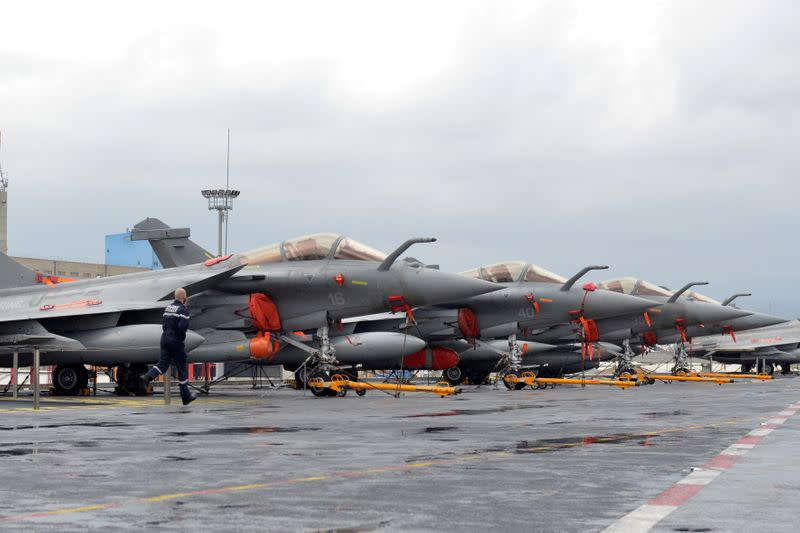 FILE PHOTO: French Navy Rafale fighter jets are seen onboard the Charles de Gaulle aircraft carrier, currently moored at the port of Limassol