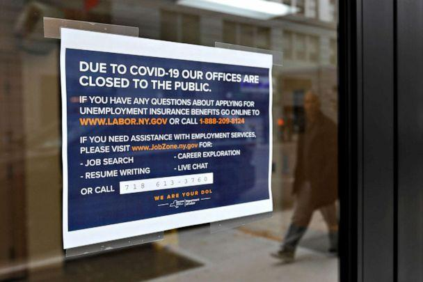 PHOTO: A sign posted on the entrance of the New York State Department of Labor offices, which closed to the public due to the coronavirus outbreak, in the Brooklyn borough of New York City, March 20, 2020. (Andrew Kelly/Reuters)
