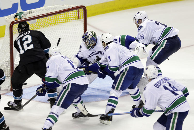 San Jose Sharks center Patrick Marleau (12) scores the game-winning goal past Vancouver Canucks goalie Cory Schneider (35) during overtime of Game 4 of their first-round NHL hockey Stanley Cup playoff series in San Jose, Calif., Tuesday, May 7, 2013. San Jose won 4-3 in overtime. (AP Photo/Marcio Jose Sanchez)