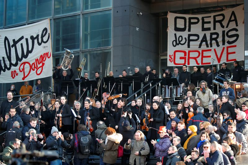 French orchestra performs improvised concert to protest pension reform in Paris