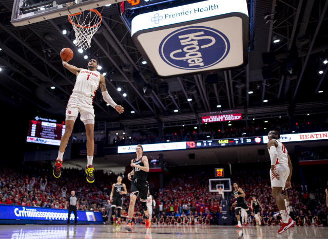 Obi Toppin goes up for a dunk against Davidson in February. (Photo by Michael Hickey/Getty Images)