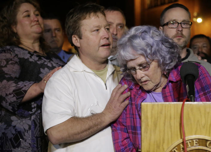 Gayle Gaddis, mother of slain Houston police officer Guy Gaddis, is helped by her son Edwin after addressing the outside the prison walls after the execution of Mexican national Edgar Tamayo Wednesday, Jan. 22, 2014, in Huntsville, Texas. Tamayo was convicted of killing Gaddis 20 years ago. The Gaddis family were witnesses to the execution. (AP Photo/Pat Sullivan)
