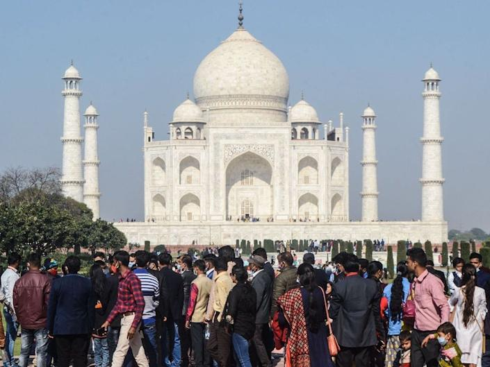 Tourists visit the Taj Mahal in Agra on December 19, 2020.