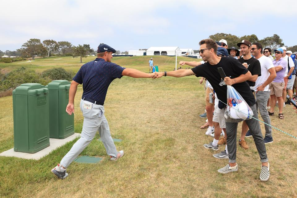SAN DIEGO, CALIFORNIA - JUNE 19: Bryson DeChambeau of the United States fist bumps a fan after playing the fourth green during the third round of the 2021 U.S. Open at Torrey Pines Golf Course (South Course) on June 19, 2021 in San Diego, California. (Photo by Sean M. Haffey/Getty Images)