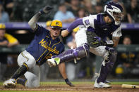 Colorado Rockies catcher Dom Nunez forces out Milwaukee Brewers' Willy Adames at home during the ninth inning of a baseball game Friday, June 18, 2021, in Denver. (AP Photo/David Zalubowski)