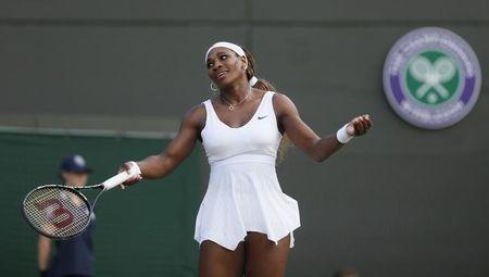 Serena Williams of the U.S. reacts during her women's singles tennis match against Alize Cornet of France at the Wimbledon Tennis Championships, in London