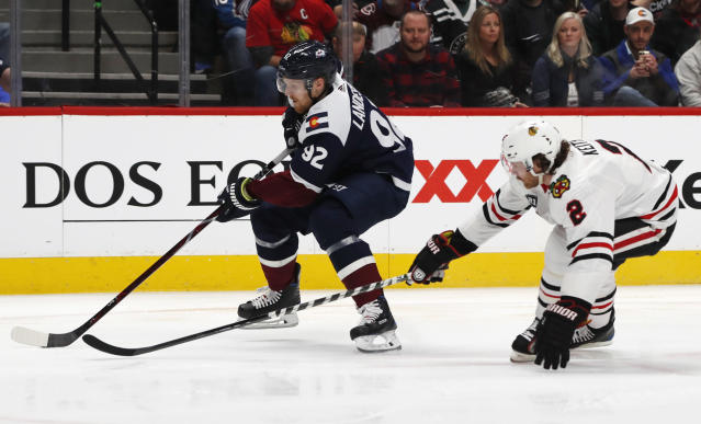 Colorado Avalanche left wing Gabriel Landeskog, left, drives past Chicago Blackhawks defenseman Duncan Keith to put a shot on the net in the first period of an NHL hockey game Saturday, Dec. 29, 2018, in Denver. (AP Photo/David Zalubowski)