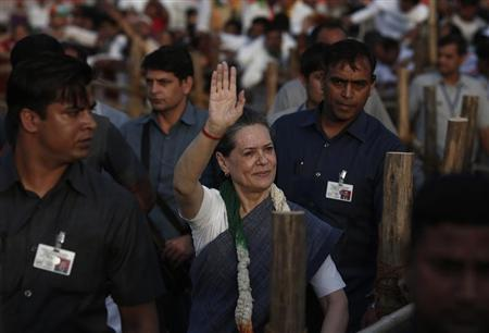 Gandhi waves towards her party supporters during a rally in New Delhi