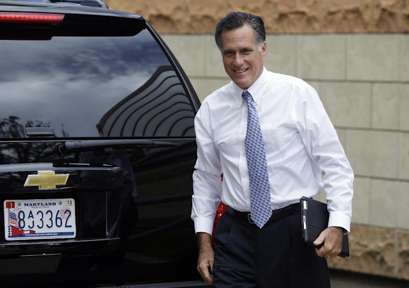 Republican presidential candidate Mitt Romney arrives at his campaign headquarters in Boston, to prepare for the presidential debates, Sunday, Sept. 9, 2012. (AP Photo/Charles Dharapak)