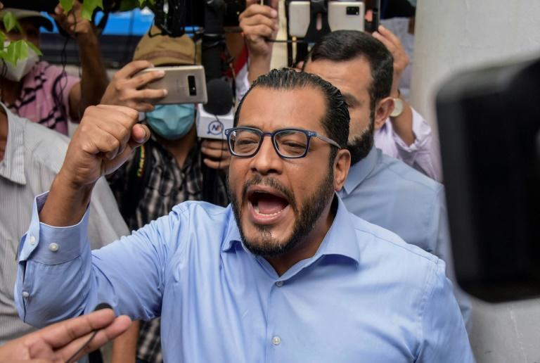 Nicaraguan presidential candidate Felix Maradiaga gestures as he arrives at the Attorney General's office amid a clampdown on opposition