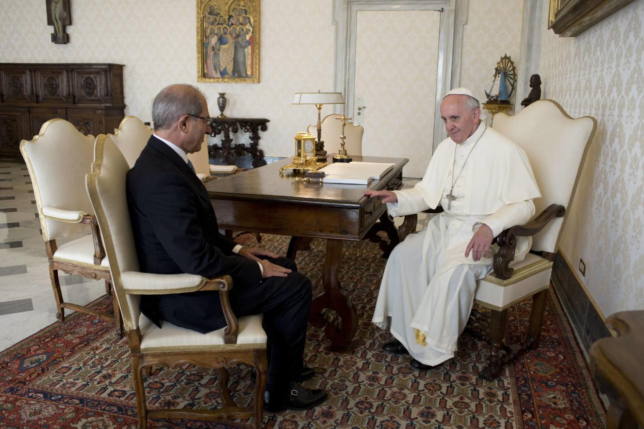 Pope Francis talks with Uzumcu, director-general of the Organisation for the Prohibition of Chemical Weapons, during a private visit at the Vatican