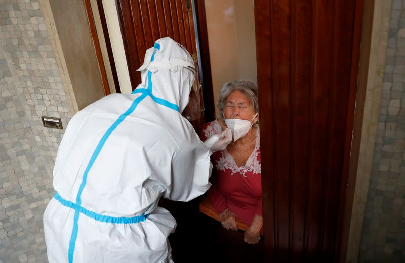 FILE PHOTO: Medics visit homes of suspected coronavirus disease (COVID-19) patients in Rome