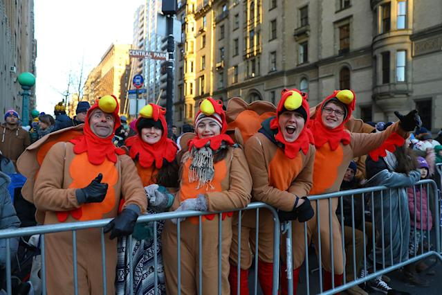 <p>People in the holiday spirit dressed as turkeys fill the parade route before the start of the 91st Macy's Thanksgiving Day Parade in New York City, Nov. 23, 2017. (Photo: Gordon Donovan/Yahoo News) </p>