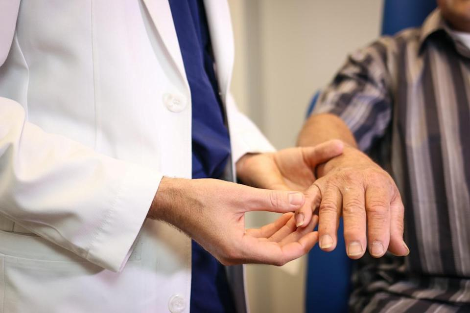 Plastic surgeon examining a hand