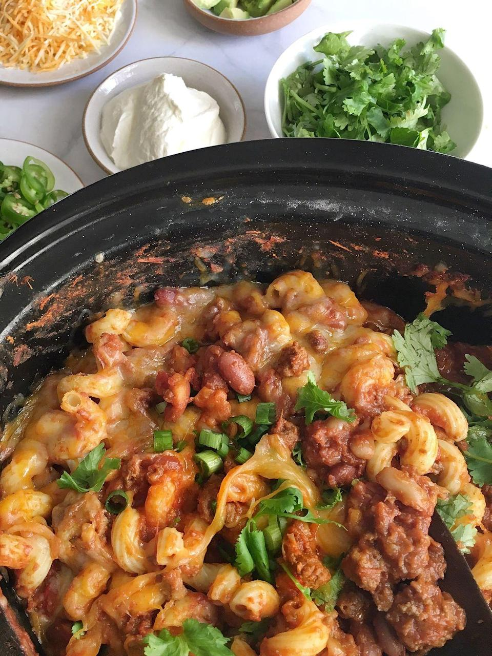 """<p>Put in a little bit of prep in the morning, come home to an insanely delish dinner.</p><p>Get the recipe from <a href=""""/cooking/recipe-ideas/recipes/a45389/slow-cooker-chili-mac-n-cheese-recipe/"""" data-ylk=""""slk:Delish"""" class=""""link rapid-noclick-resp"""">Delish</a>.</p>"""