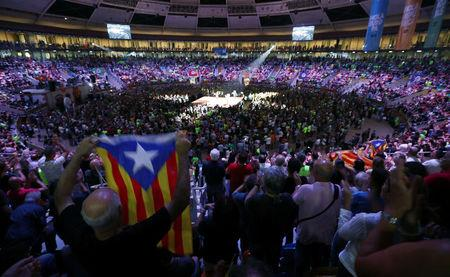 People attend a Catalan pro-independence meeting at Tarraco Arena in Tarragona