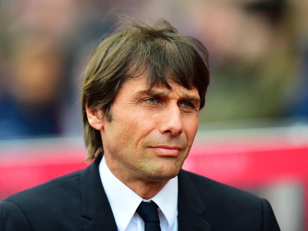Antonio Conte has asked Chelsea to delay contract talks until the Premier League title has been won: Getty
