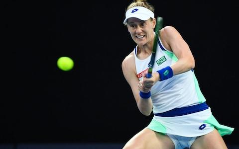 Alison Riske of the US hits a return against Australia's Ashleigh Barty during their women's singles match on day seven of the Australian Open tennis tournament in Melbourne