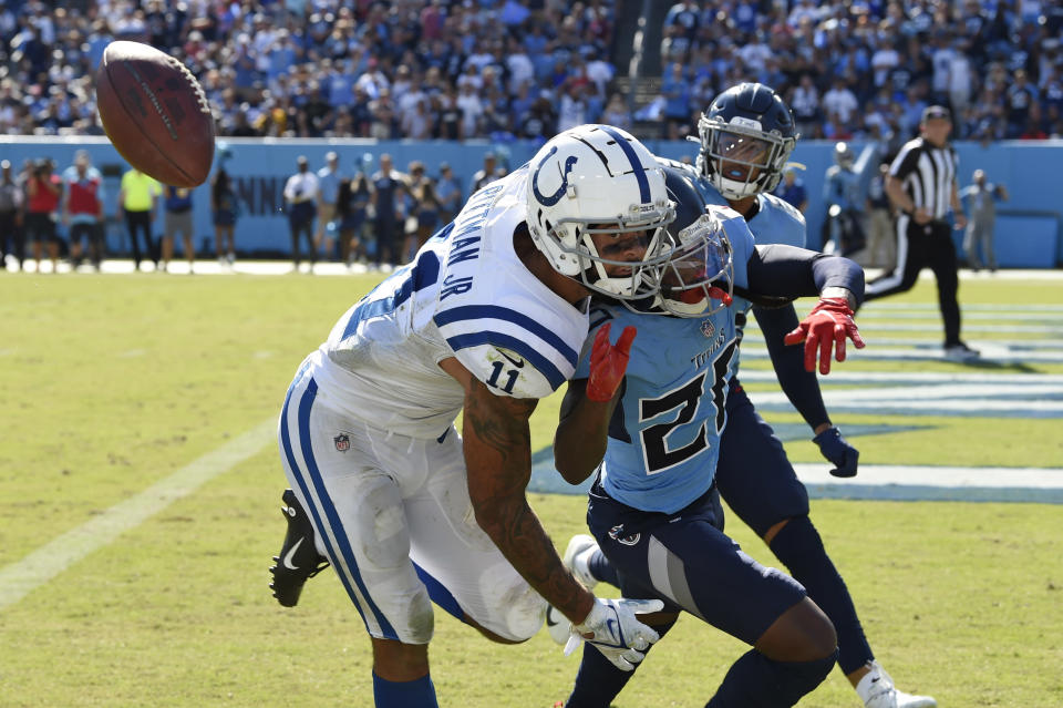 Indianapolis Colts wide receiver Michael Pittman Jr. (11) can't hold onto a pass as he is defended by Tennessee Titans cornerback Jackrabbit Jenkins (20) in the second half of an NFL football game Sunday, Sept. 26, 2021, in Nashville, Tenn. (AP Photo/Mark Zaleski)