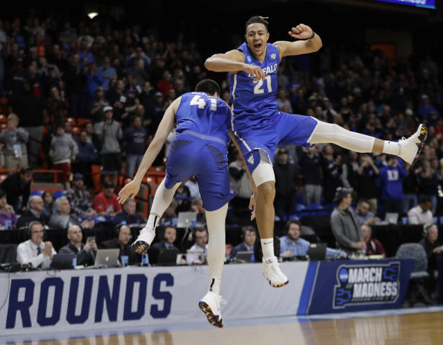 Buffalo's Dominic Johnson, right, and Brock Bertram celebrate after Buffalo upset Arizona 89-68 in first-round game in the NCAA men's college basketball tournament. (AP)