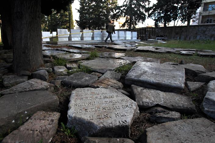 Headstones destroyed during the Nazi occupation of Greece during World War II and recovered after they were found buried in a plot of land are seen on the ground at a Jewish cemetery, in the northern port city of Thessaloniki, Greece, Thursday, Dec. 20, 2012. Police in northern Greece say they recovered more than 600 marble headstones and other fragments from Jewish graves destroyed during the Nazi occupation in World War II — a find that local Jewish groups have described as highly significant. (AP Photo/Nikolas Giakoumidis)
