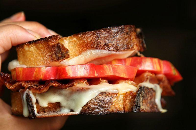 """<p>Spread mayo on the bread for a gloriously golden-brown crust.</p><p>Get the <a href=""""https://www.delish.com/uk/cooking/recipes/a33519315/grilled-cheese-with-tomatoes-and-bacon-recipe/"""" rel=""""nofollow noopener"""" target=""""_blank"""" data-ylk=""""slk:Grilled Cheese with Tomatoes and Bacon"""" class=""""link rapid-noclick-resp"""">Grilled Cheese with Tomatoes and Bacon</a> recipe.</p>"""