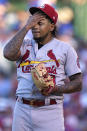 St. Louis Cardinals starting pitcher Carlos Martinez reacts as he wipes his face during the third inning of a baseball game against the Chicago Cubs in Chicago, Sunday, June 13, 2021. (AP Photo/Nam Y. Huh)