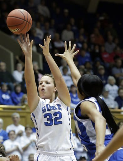 Duke's Tricia Liston (32) shoots as Hampton's Ariel Phelps defends during the first half of a first-round game in the women's NCAA college basketball tournament in Durham, N.C., Sunday March 24, 2013. (AP Photo/Gerry Broome)