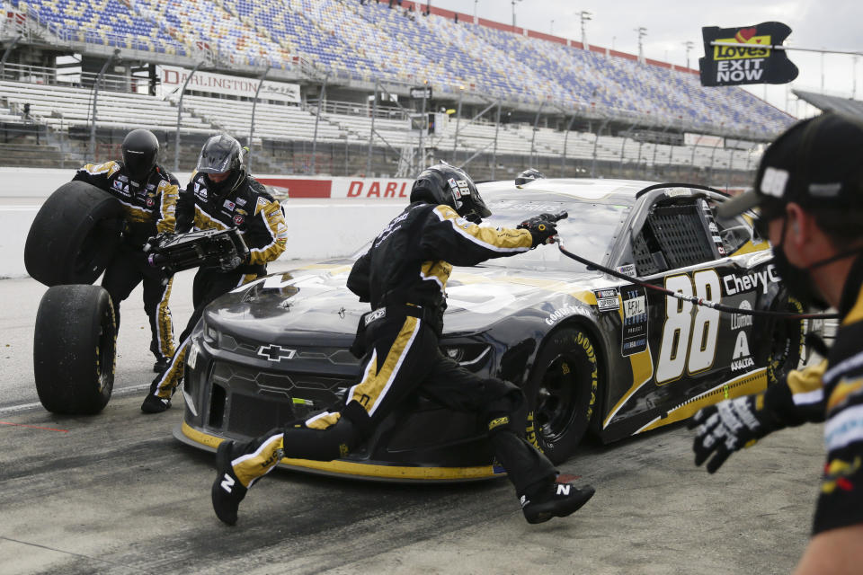 Alex Bowman (88) makes a pit stop during the NASCAR Cup Series auto race Sunday, May 17, 2020, in Darlington, S.C. (AP Photo/Brynn Anderson)