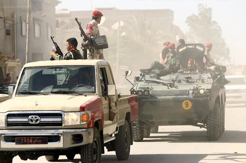 Security forces patrol a street in the city of Benghazi on June 25, 2014 (AFP Photo/)