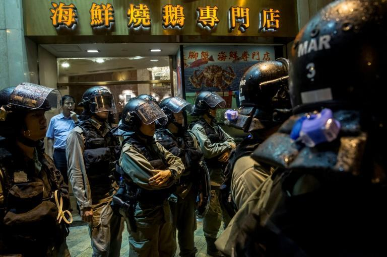 Hong Kong officers arrested for beating man in hospital