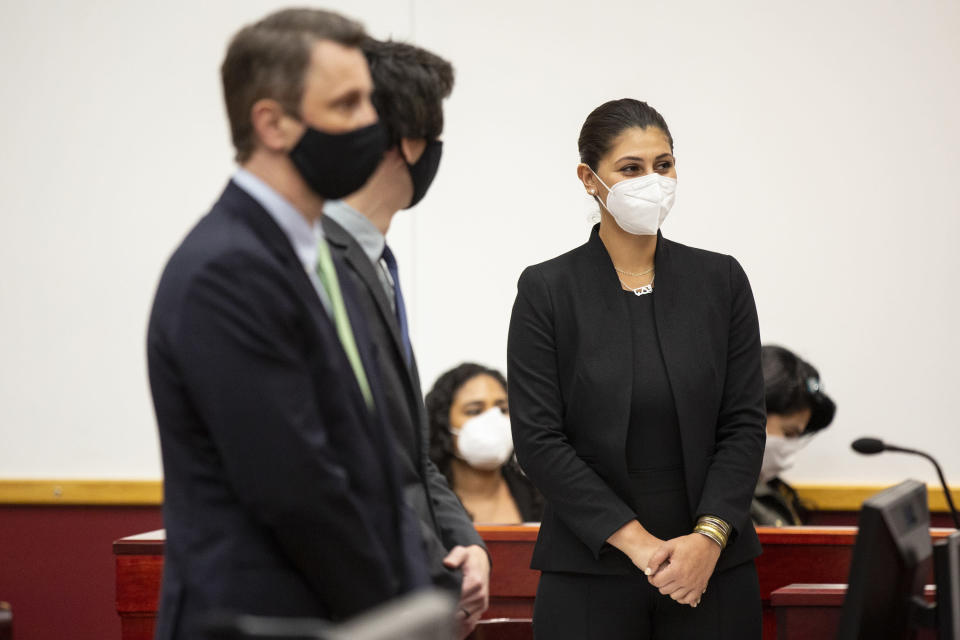 Des Moines Register Reporter Andrea Sahouri, right, learns she's been found not-guilty at the conclusion of her trial at the Drake University Legal Clinic, Wednesday, March 10, 2021, in Des Moines, Iowa. The jury acquitted Sahouri, who was pepper-sprayed and arrested by police while covering a protest last summer in a case that critics have derided as an attack on press freedom and an abuse of prosecutorial discretion. (Kelsey Kremer/The Des Moines Register via AP, Pool)
