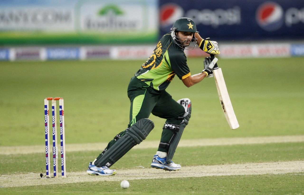 Pakistan's Shahid Afridi plays a shot during their first Twenty20 international cricket match against South Africa in Dubai November 13, 2013. REUTERS/Nikhil Monteiro (UNITED ARAB EMIRATES - Tags: SPORT CRICKET)