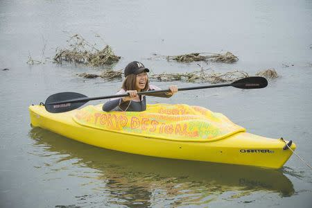 Japanese artist Megumi Igarashi, known as Rokudenashiko, paddles in her kayak modeled on her vagina in the Tama river in Tokyo