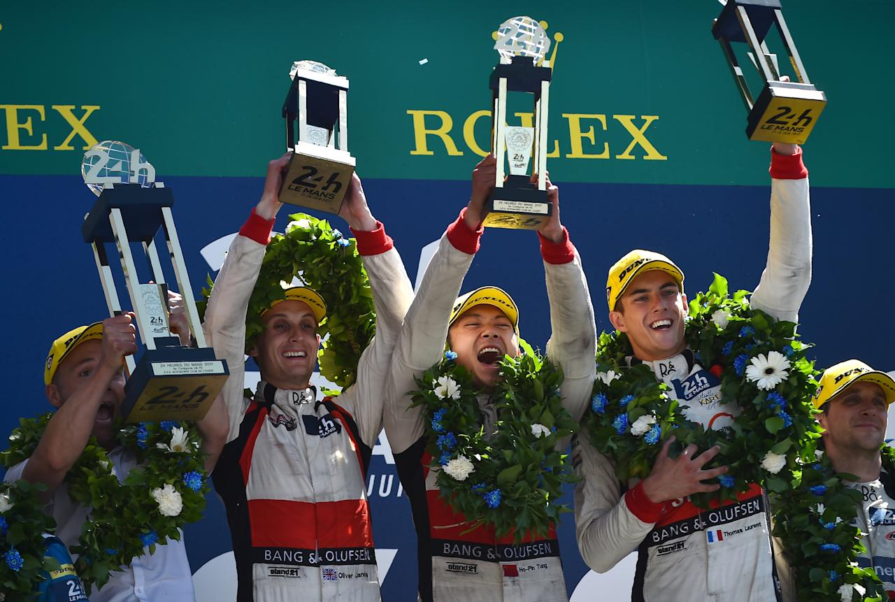 England's driver Olivier Jarvis (2L) and French's driver Thomas Laurent (2R) of Jackie Chan Racing ORECA 07-Gibson N°38 team celebrate on the podium after winning the LMP2 Category and the second place of the 85th Le Mans 24-hours endurance race on June 18, 2017 in Le Mans, western France. (AFP Photo/JEAN-FRANCOIS MONIER)