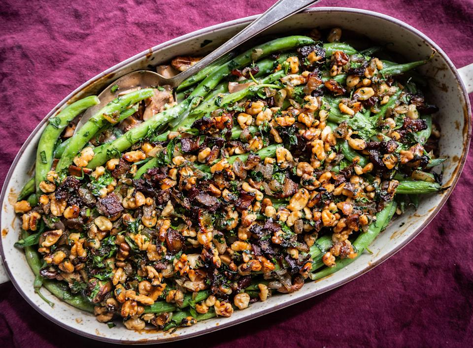 """Chanterelle mushrooms and a crunchy, sweet, and salty walnut-bacon topping make this harvest festival side dish a winner. Start your weekend with a foraging expedition if you're lucky enough to have a spot for chanterelles. (They've been known to pop up in British Columbia, Ontario, and Quebec.) <a href=""""https://www.epicurious.com/recipes/food/views/green-bean-casserole-with-walnut-bacon-crumble?mbid=synd_yahoo_rss"""" rel=""""nofollow noopener"""" target=""""_blank"""" data-ylk=""""slk:See recipe."""" class=""""link rapid-noclick-resp"""">See recipe.</a>"""