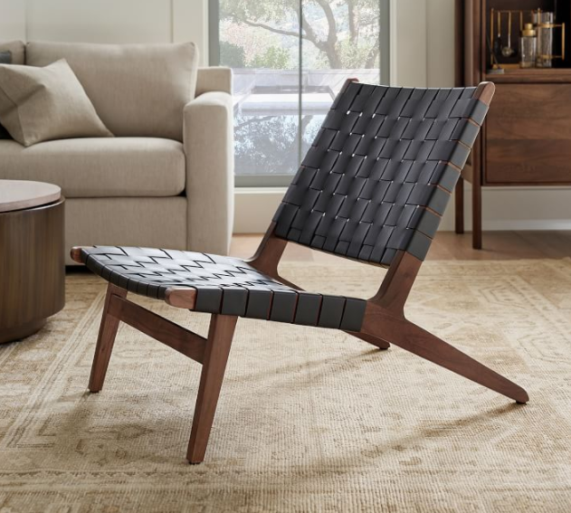 """<p>potterybarn.com</p><p><strong>$799.00</strong></p><p><a href=""""https://go.redirectingat.com?id=74968X1596630&url=https%3A%2F%2Fwww.potterybarn.com%2Fproducts%2Ffenton-leather-armchair&sref=https%3A%2F%2Fwww.elledecor.com%2Fhome-remodeling-renovating%2Fhome-makeovers%2Fg36087440%2Feasy-diy-home-renovation-projects%2F"""" rel=""""nofollow noopener"""" target=""""_blank"""" data-ylk=""""slk:Shop Now"""" class=""""link rapid-noclick-resp"""">Shop Now</a></p><p>If you feel like your main living space needs an update, start off small and buy a piece of accent furniture. A modern piece can make all the difference. If you have an old chair that you'd like to transform, you can play around with fabrics for reupholstering.</p>"""