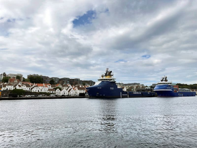 Offshore oil and gas platform supply vessels are docked at a pier in Stavanger