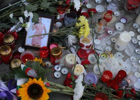 Flowers and candles are placed in memory of Bulgarian TV journalist Viktoria Marinova in Ruse, Bulgaria, October 9, 2018. REUTERS/Stoyan Nenov