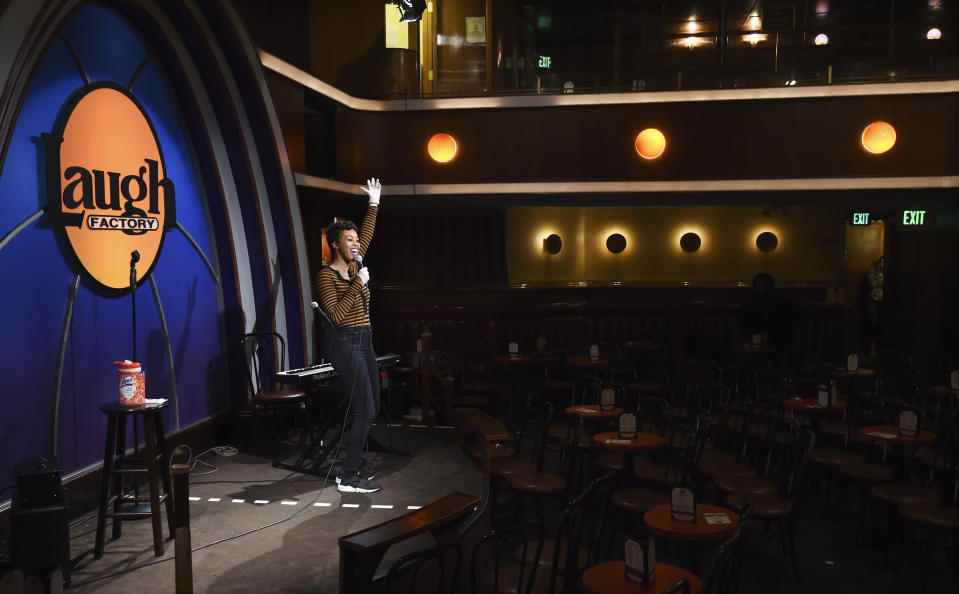"""Comedian Daphnique Springs performs to an empty room during a """"Laughter is Healing"""" stand-up comedy livestream event at the Laugh Factory comedy club, Monday, April 20, 2020, in Los Angeles. (AP Photo/Chris Pizzello)"""